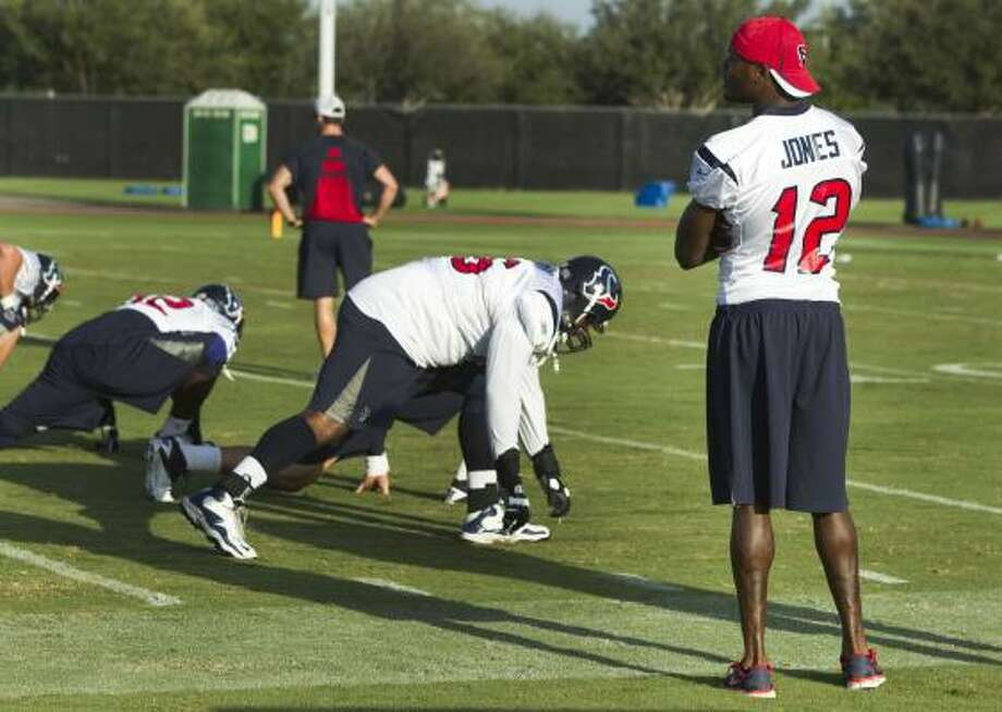 Texans wide receiver Jacoby Jones stands on the sidelines watching practice. Jones missed the morning practice because of a sprained ankle. Photo: Brett Coomer, Chronicle