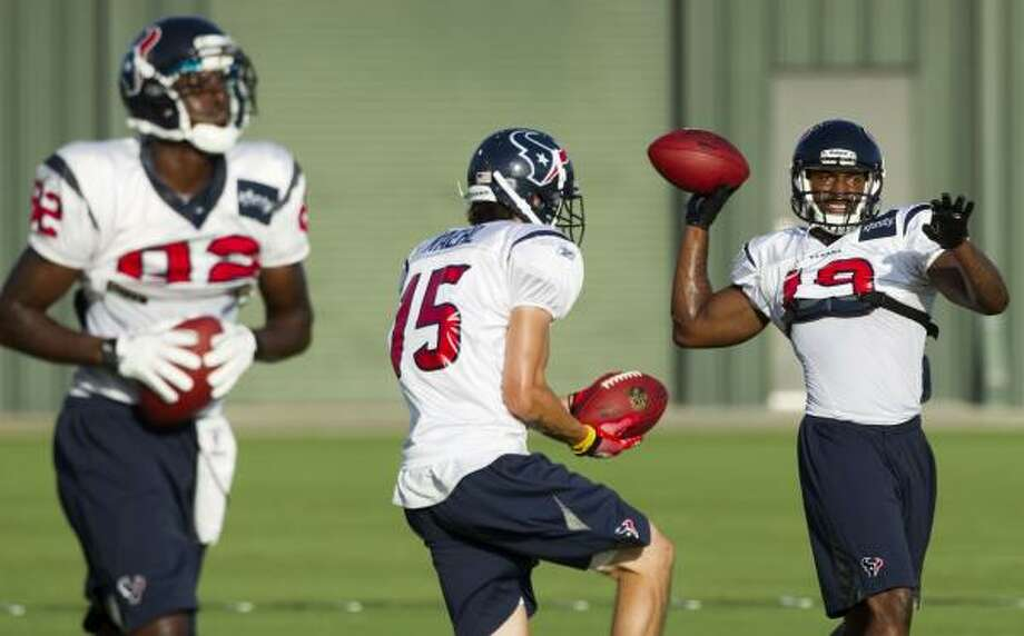 Texans wide receivers Terrence Toliver (82), Jeff Maehl (15) and Dorin Dickerson (19) run through a drill. Photo: Brett Coomer, Chronicle