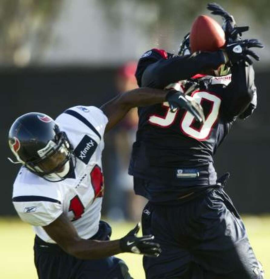 Texans cornerback Jason Allen breaks up a pass intended for wide receiver Derrick Townsel. Photo: Brett Coomer, Chronicle