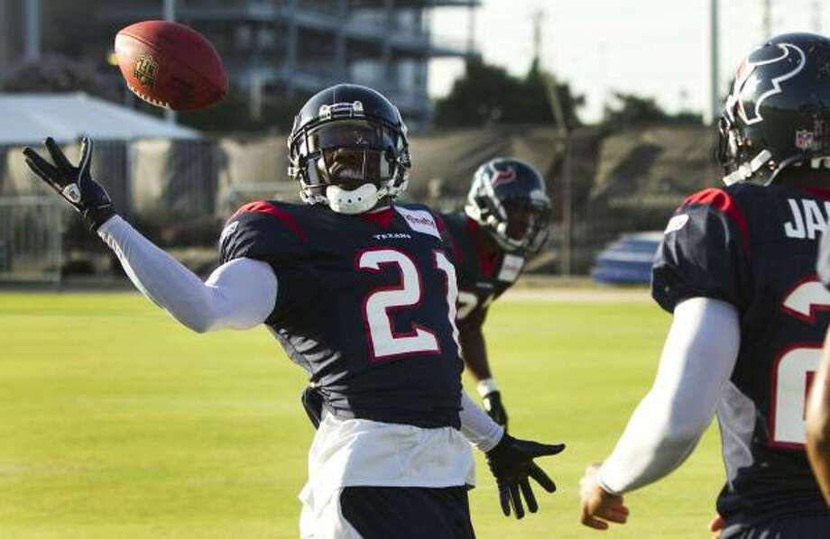 Texans corberback Brice McCain reaches for a ball during a drill. Photo: Brett Coomer, Chronicle