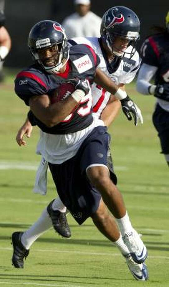 Texans safety Quintin Demps runs a punt past punter Brad Maynard. Photo: Brett Coomer, Chronicle