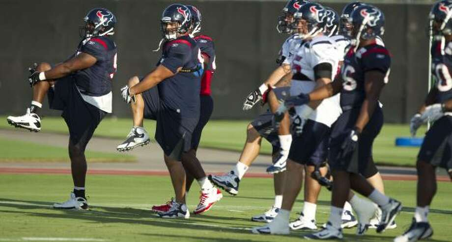 Texans players warm up before practice. Photo: Brett Coomer, Chronicle