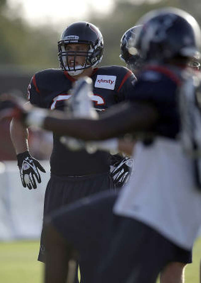 Texans linebacker Brian Cushing (56) stretches with teammates before a drill. Photo: Karen Warren, Chronicle
