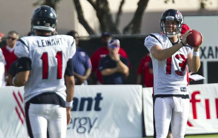 Texans quarterbacks Matt Leinart, left, and T.J. Yates warm up before practice. Photo: James Nielsen, Chronicle