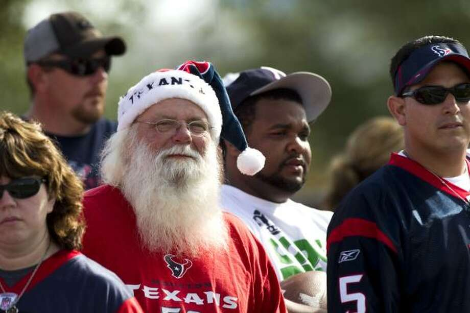 Houston Texans fan Mark Hulsey, white beard, watches practice during Texans training camp. Photo: Brett Coomer, Houston Chronicle