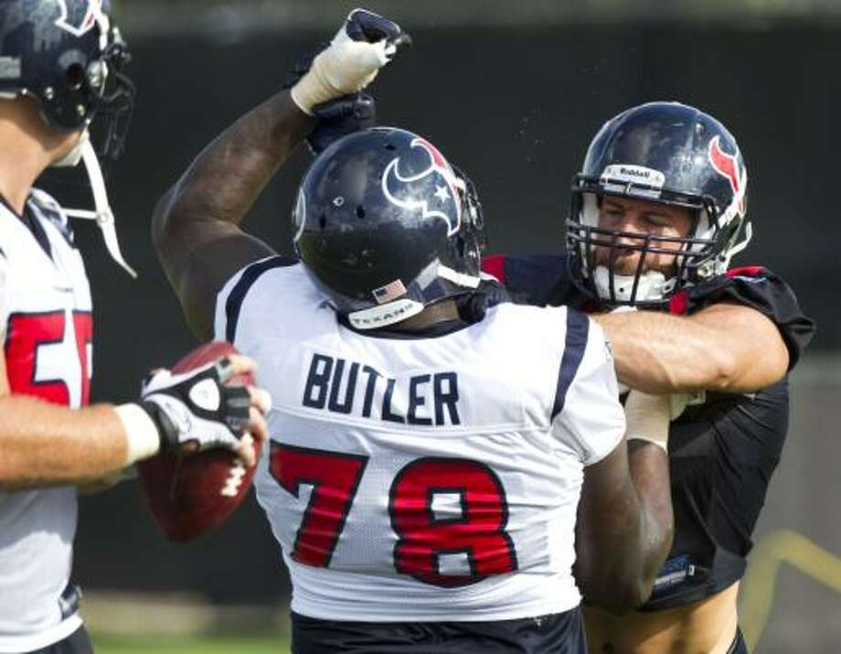 Texans linebacker Connor Barwin, right, battles with tackle Rashad Butler (78). Photo: Brett Coomer, Chronicle
