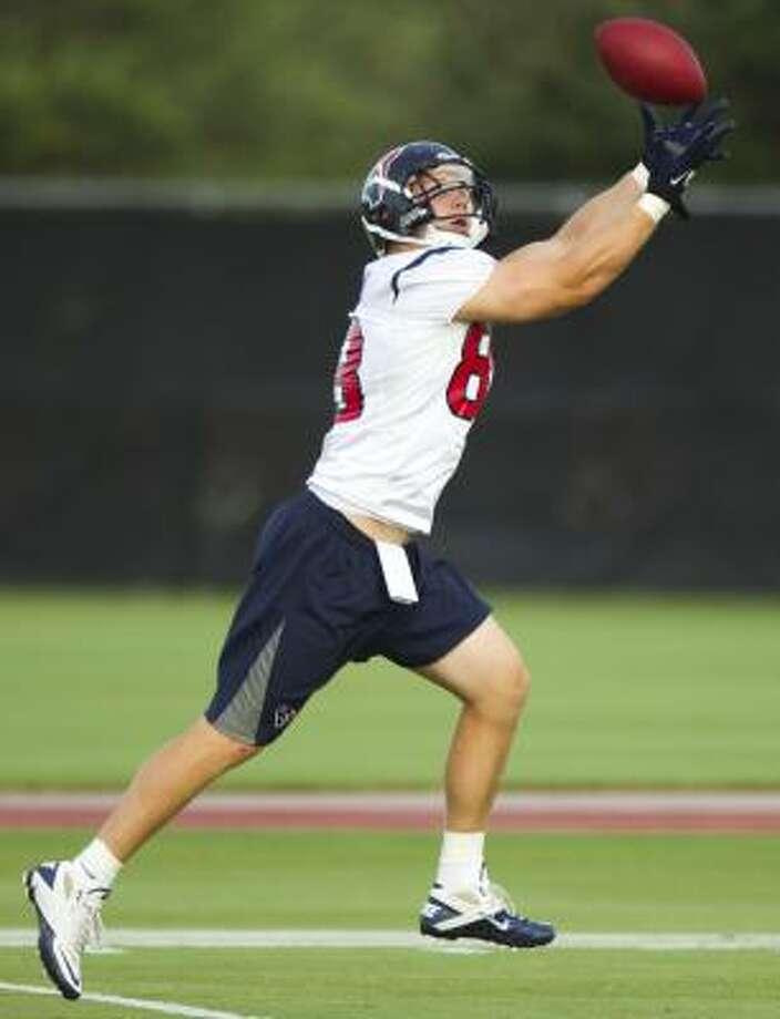 Texans tight end Garrett Graham reaches out for a pass. Photo: Brett Coomer, Chronicle