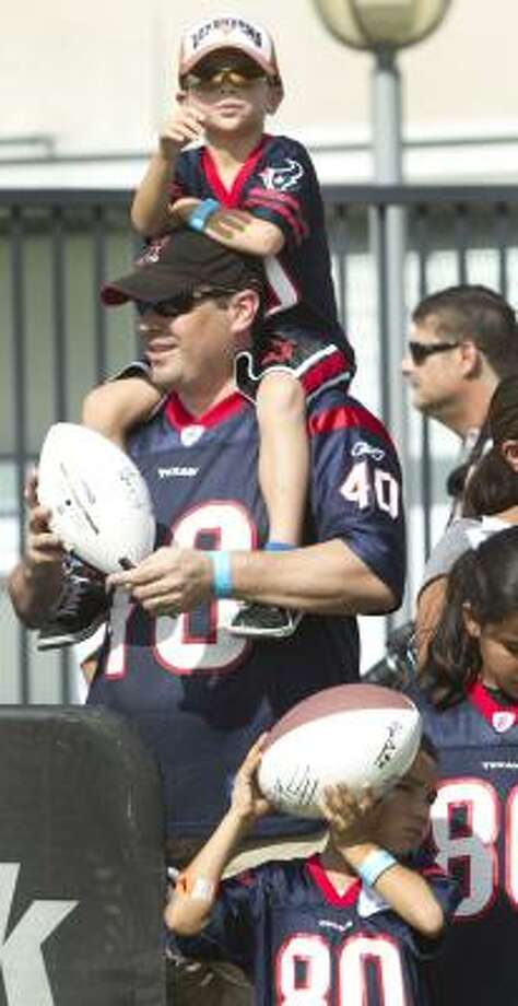 Texans fans watch practice during training camp at the Methodist Training Center. Photo: Brett Coomer, Chronicle