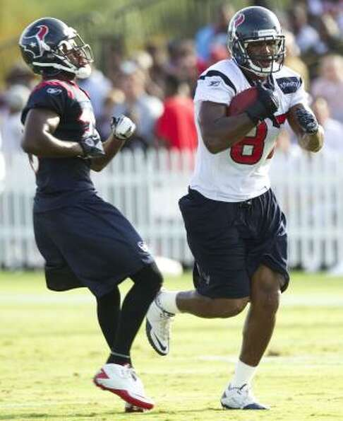 Texans tight end Anthony Hill runs past safety Troy Nolan after a catch.