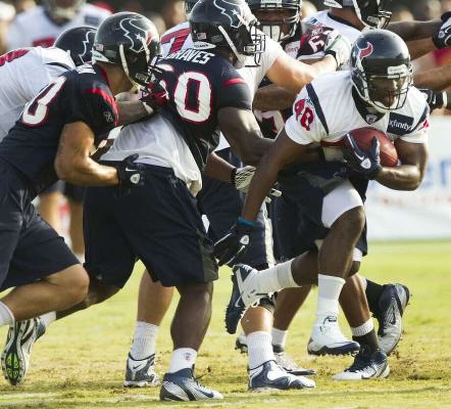 Texans running back Javarris Williams runs the ball during a scrimmage. Photo: Brett Coomer, Chronicle