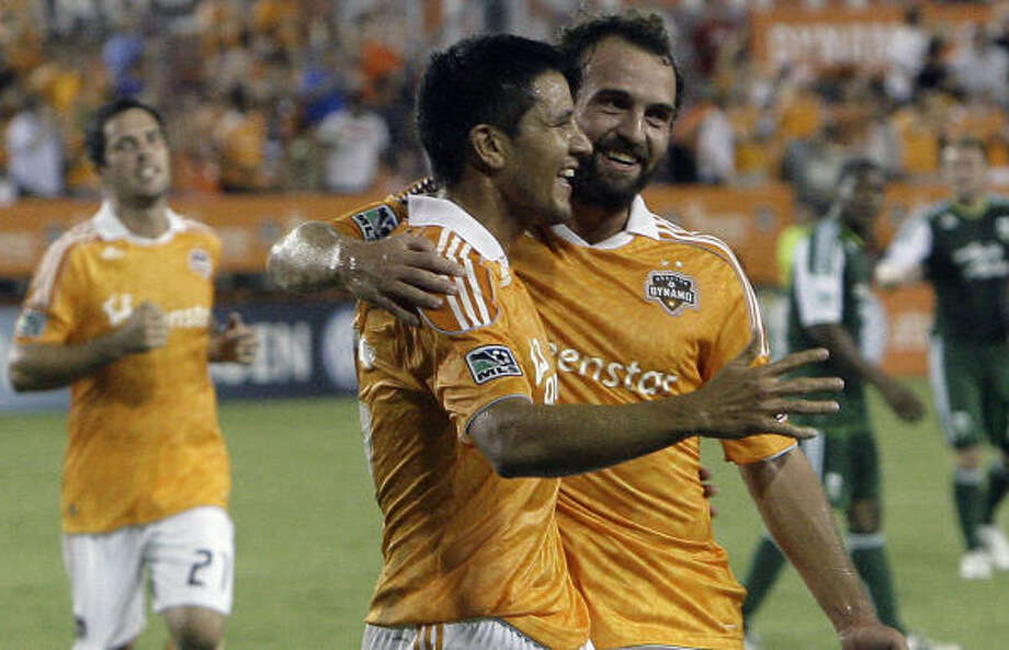 August 14: Dynamo 2,Timbers 1The Houston Dynamo Brian Ching (center) is greeted by teammate Adam Moffat (right) after Ching scored. Photo: Cody Duty, Houston Chronicle