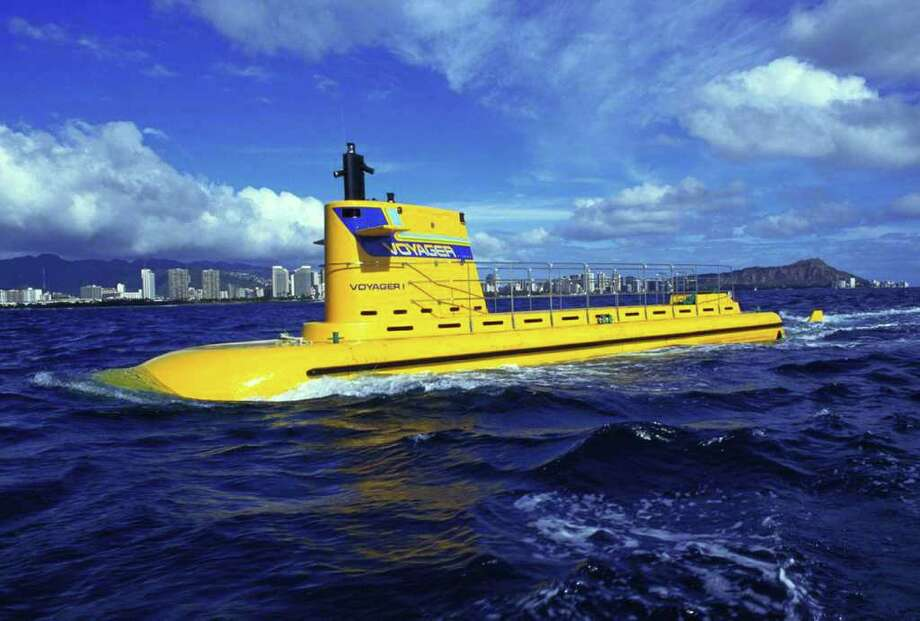 Submarines! While this one pictured isn't one of Paul Allen's, his Octopus yacht houses a 10-man yellow submarine (Allen's a music fan) and a smaller, remote-control submersible for exploring the ocean floor. Photo: Getty Images / Getty Images North America