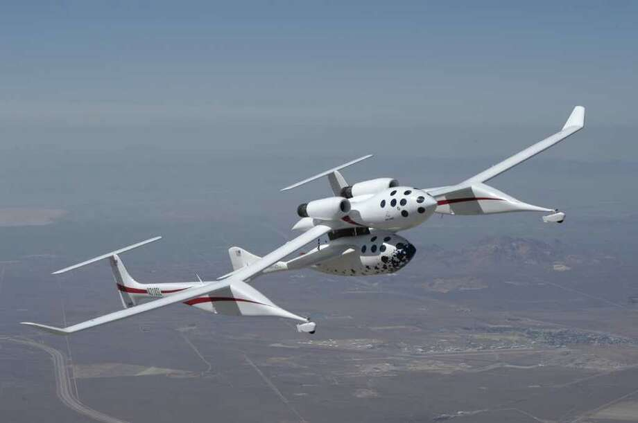Scaled Composites took the idea to a new level with the custom White Knight mothership it built to carry SpaceShipOne to 50,000 feet. The rocket then launched away to become the first private craft to carry people into space in 2004. Photo: Getty Images / 2004 Getty Images