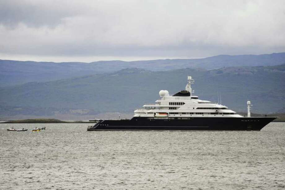 "Paul Allen also owns one of the world's largest yachts. The 414-foot ""Octopus"" has two helipads, a pool, a basketball court, at least seven smaller boats, hatches from which to launch jet skis, and not one but two ... Photo: SELKNAM USH, AFP/Getty Images / 2011 AFP"