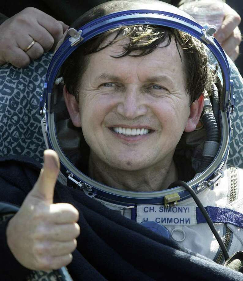 Former Microsoft developer Charles Simonyi spent $60 million to turn himself into a space tourist -- twice. He hitched a ride on two Russian Soyuz missions to the International Space Station. Photo: MIKHAIL METZEL, AFP/Getty Images / 2009 AFP