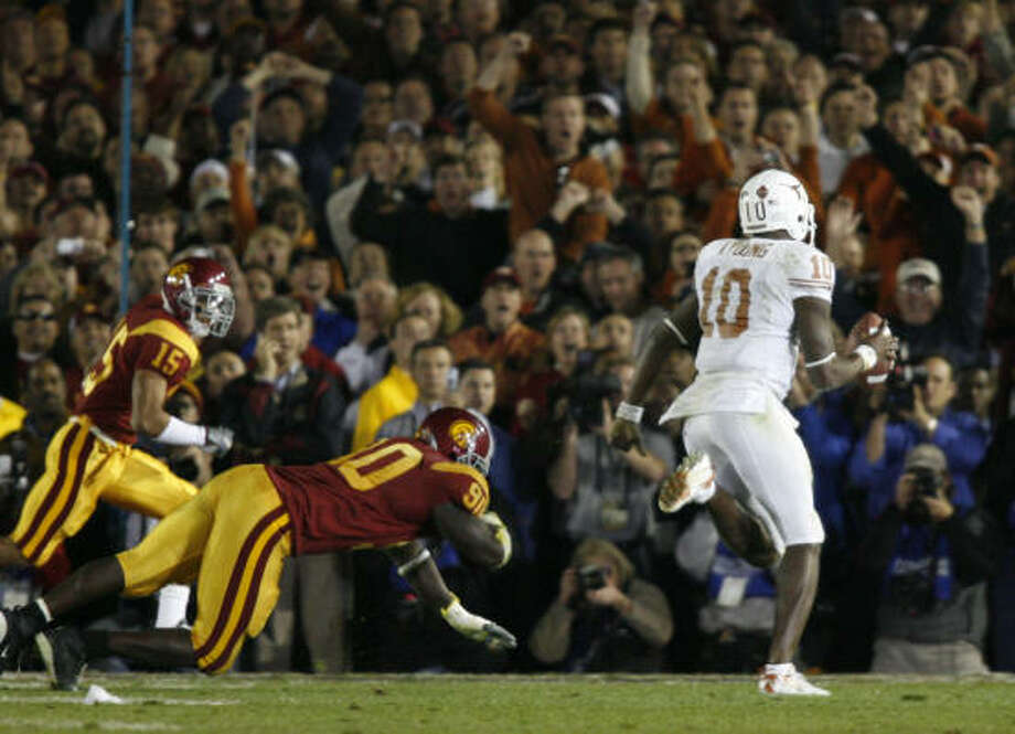 Vince's finest momentJan. 4, 2006: Having already amassed a career's worth of highlight-reel mastery in pivotal situations, Texas quarterback Vince Young authored one more in the closing seconds of the Rose Bowl with the national title on the line against USC. On fourth-and-5 from the Trojans' 8, Young took the snap, dropped three steps back, then raced to the right corner of the end zone to lift the Longhorns to their first championship in 35 years. Photo: Nick De La Torre, HOUSTON CHRONICLE