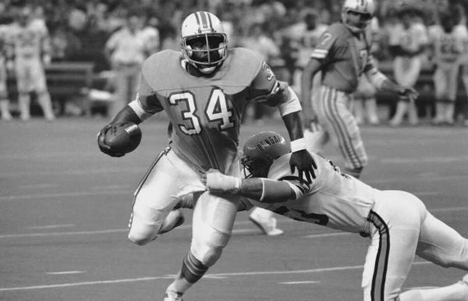 Earl Campbell (34) running back for the Houston Oilers cannonballs through the defending Cincinnati Bengals for a 36 yard gain to set up an Oilers Touchdown at the end of the first half, Nov. 19, 1979 in Houston. Bo Harris (53) a Bengal linebacker finally brings Campbell down at the two yard line. The Oilers had rushed for over 300 yards in the first half of play. (AP Photo) Photo: Anonymous, ASSOCIATED PRESS