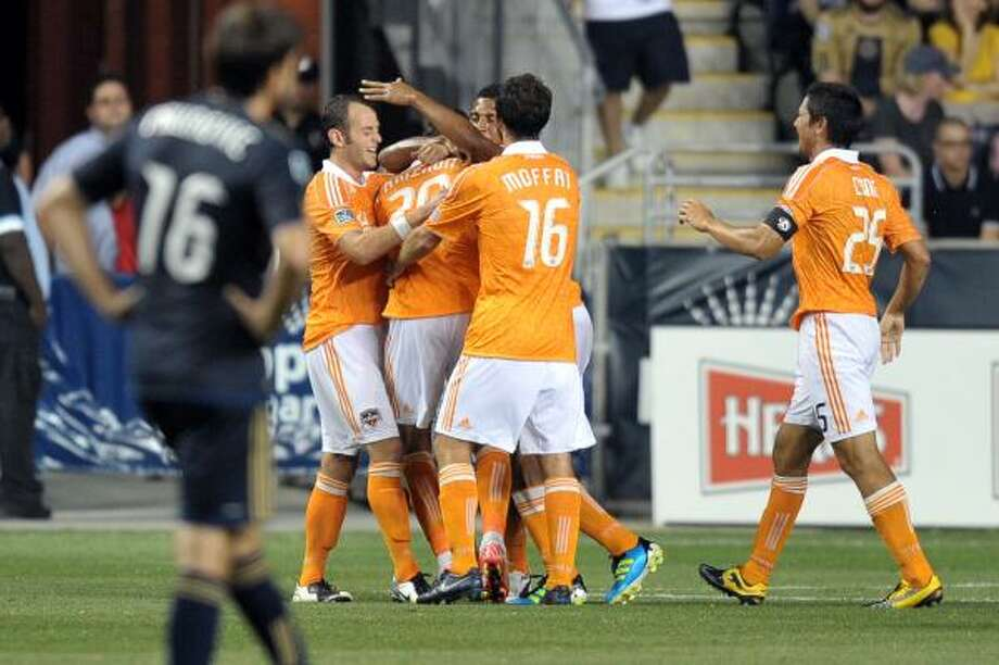 Aug. 6: Dynamo 1, Union 1The Dynamo surround midfielder Geoff Cameron (20) after he scored a goal late in the second half of Saturday's match to help his squad capture a 1-1 tie with the Union. Photo: Drew Hallowell, Getty