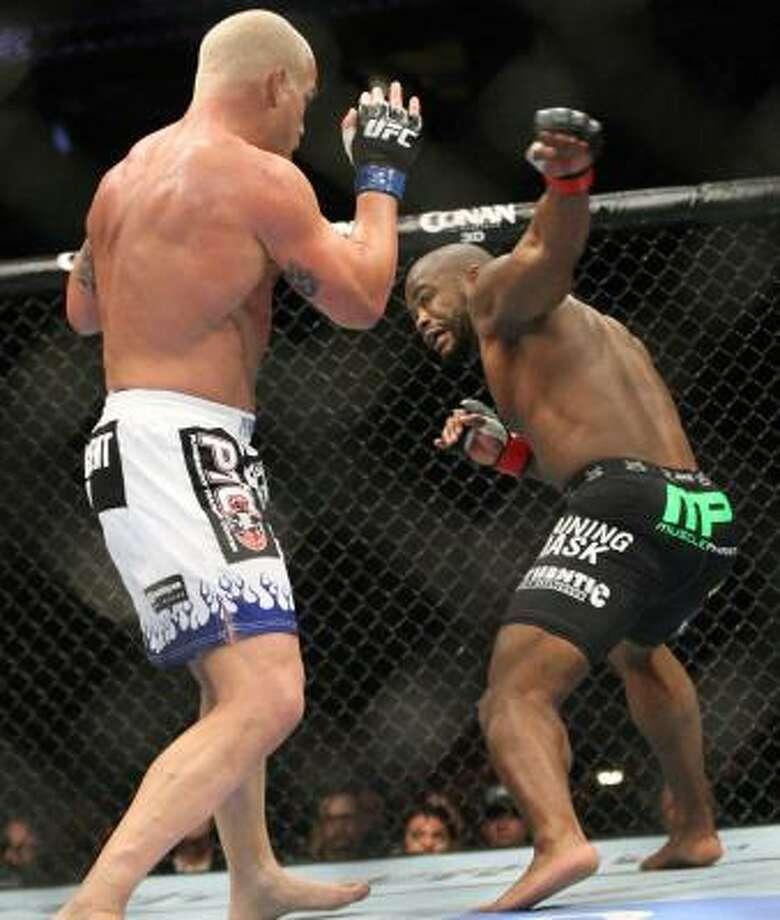 Rashad Evans, right, battles Tito Ortiz in the second round. Photo: Suchat Pederson, Associated Press