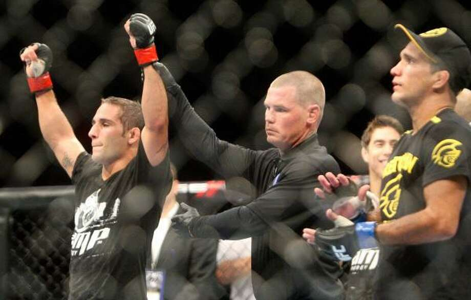 Chad Mendes, left, celebrates after winning a unanimous decision over Rani Yahya. Photo: Daniel Sato, Associated Press