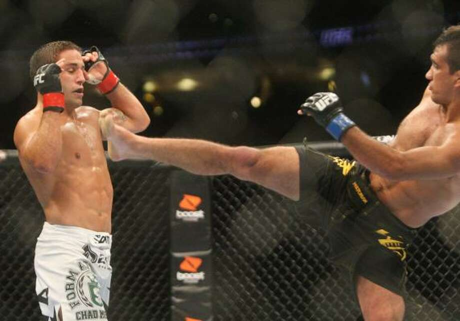 Chad Mendes, left, backs away from a kick by Rani Yahya. Photo: Daniel Sato, Associated Press