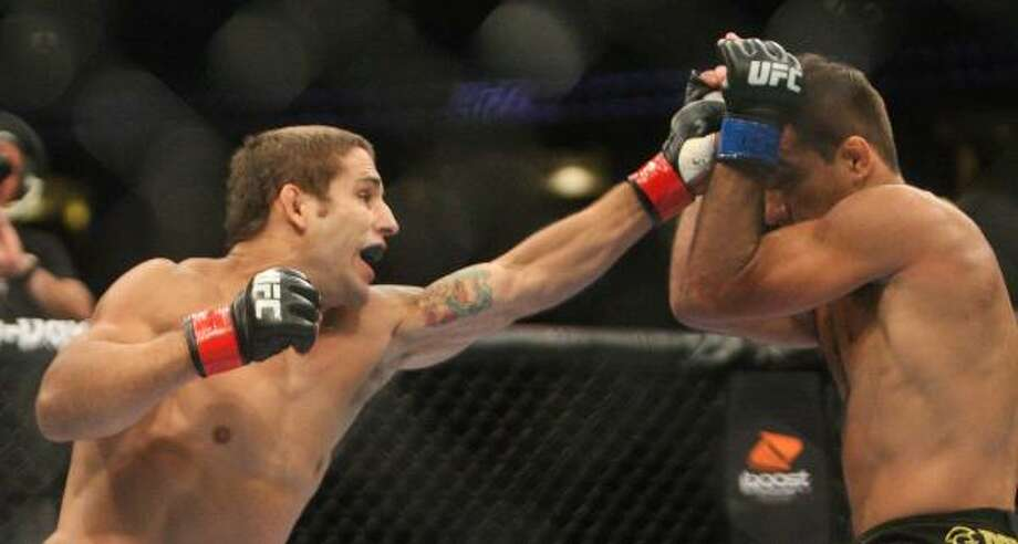 Chad Mendes, left, throws a punch to Rani Yahya. Photo: Daniel Sato, Associated Press