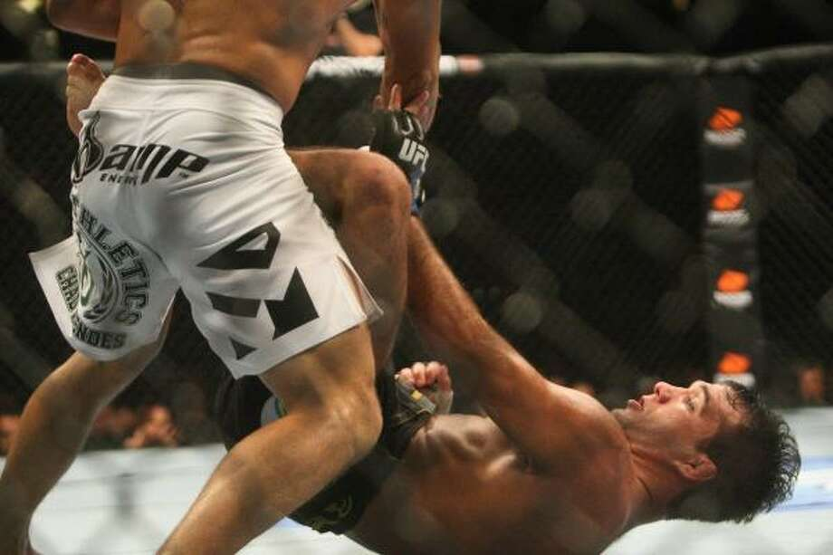 Chad Mendes looks down at Rani Yahya. Photo: Daniel Sato, Associated Press
