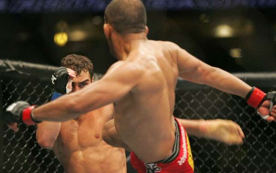 Ivan Menjivar, right, delivers a kick to Nick Pace. Photo: Andrew Renneisen, Associated Press