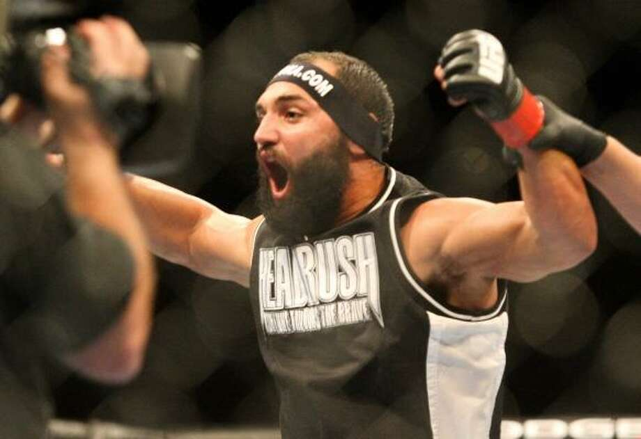 Johny Hendricks celebrates as he wins by split decision against Mike Pierce in a welterweight bout. Photo: Andrew Renneisen, Associated Press