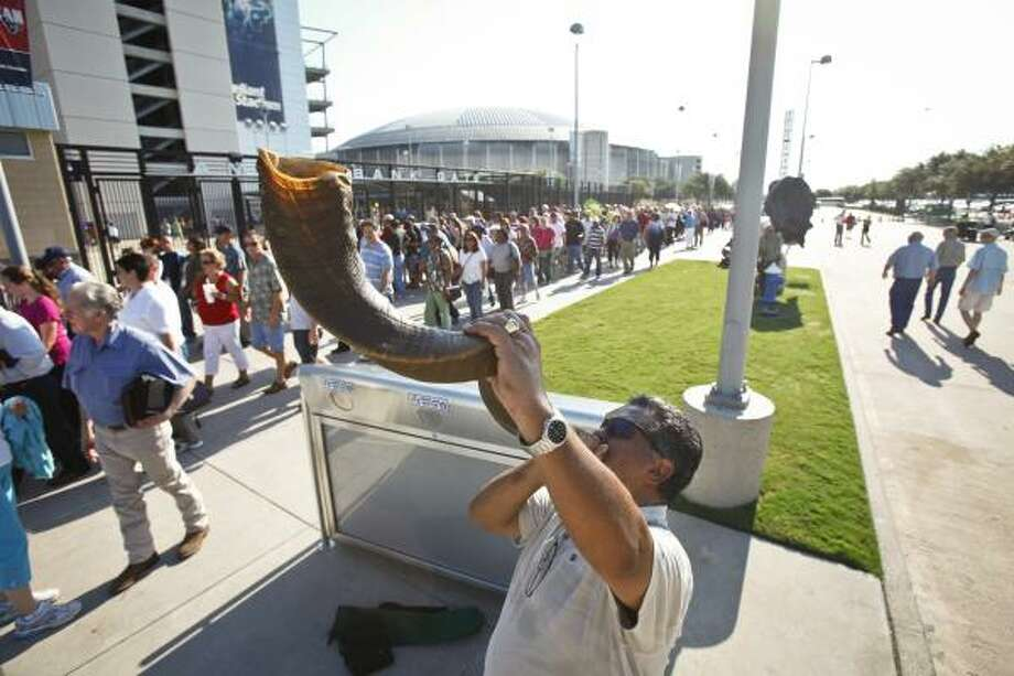 Jack Gonzales sounds a shofar, a horn used for religious purposes, outside Reliant Stadium as people arrive for The Response: A Call to Prayer for a Nation in Crisis rally Saturday in Houston. Photo: Michael Paulsen, Houston Chronicle