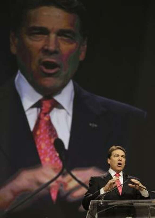 "Perry addressed the church-state issue in his own way, saying God's ""agenda is not a political agenda, it's a salvation agenda."" Photo: Melissa Phillip, Houston Chronicle"