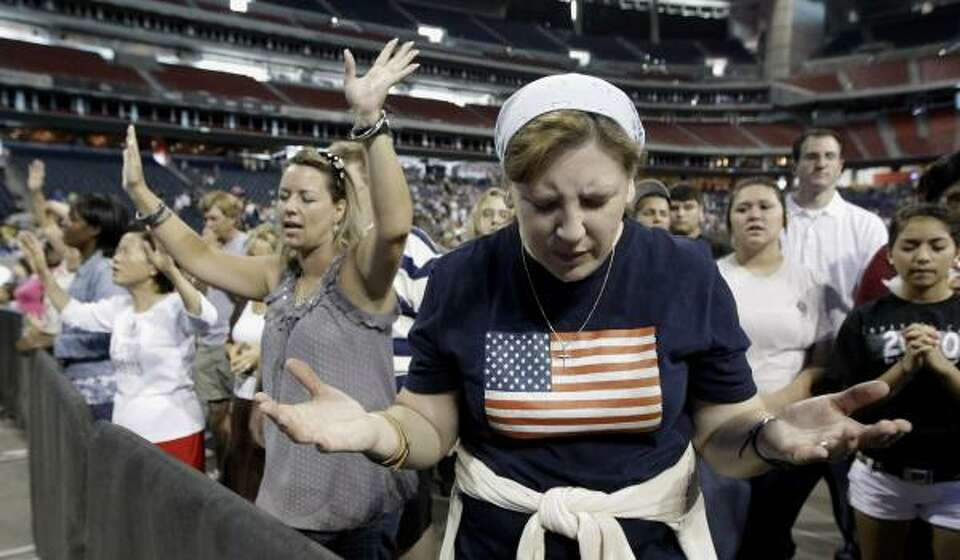 Lucy West, of Killeen, prays at