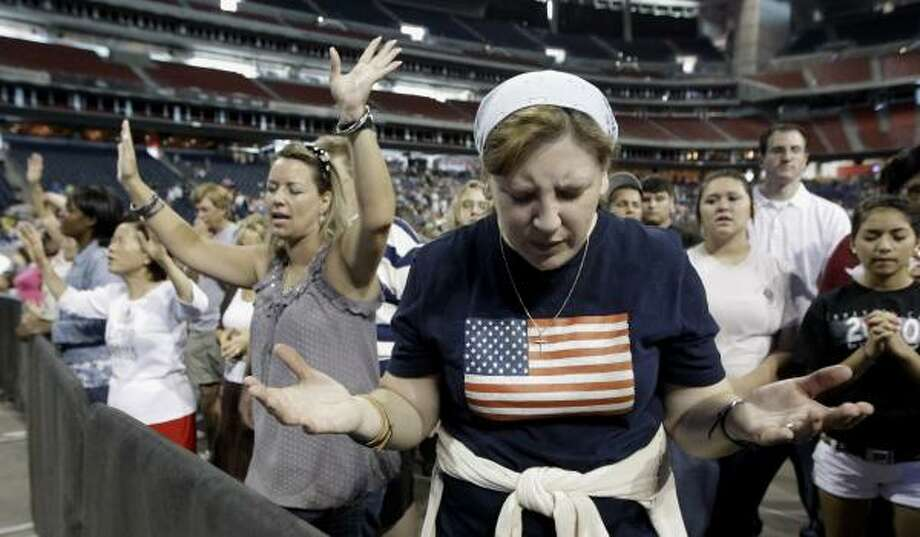 "Lucy West, of Killeen, prays at ""The Response."" Photo: David J. Phillip, Associated Press"
