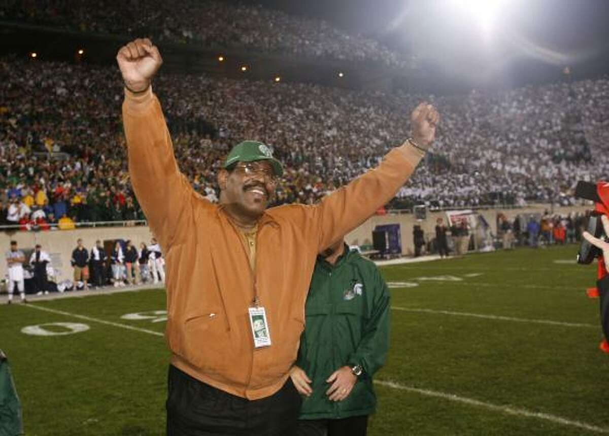 Former Michigan State football player Bubba Smith raises his arms during a ceremony at which his jersey number was retired. Smith, a former NFL defensive star who found a successful second career as an actor, died Wednesday, Aug. 3, 2011, in Los Angeles at age 66. Los Angeles County coroner's spokesman Ed Winter said Smith was found dead at his Baldwin Hills home. Winter said he didn't know the circumstances or cause of death.