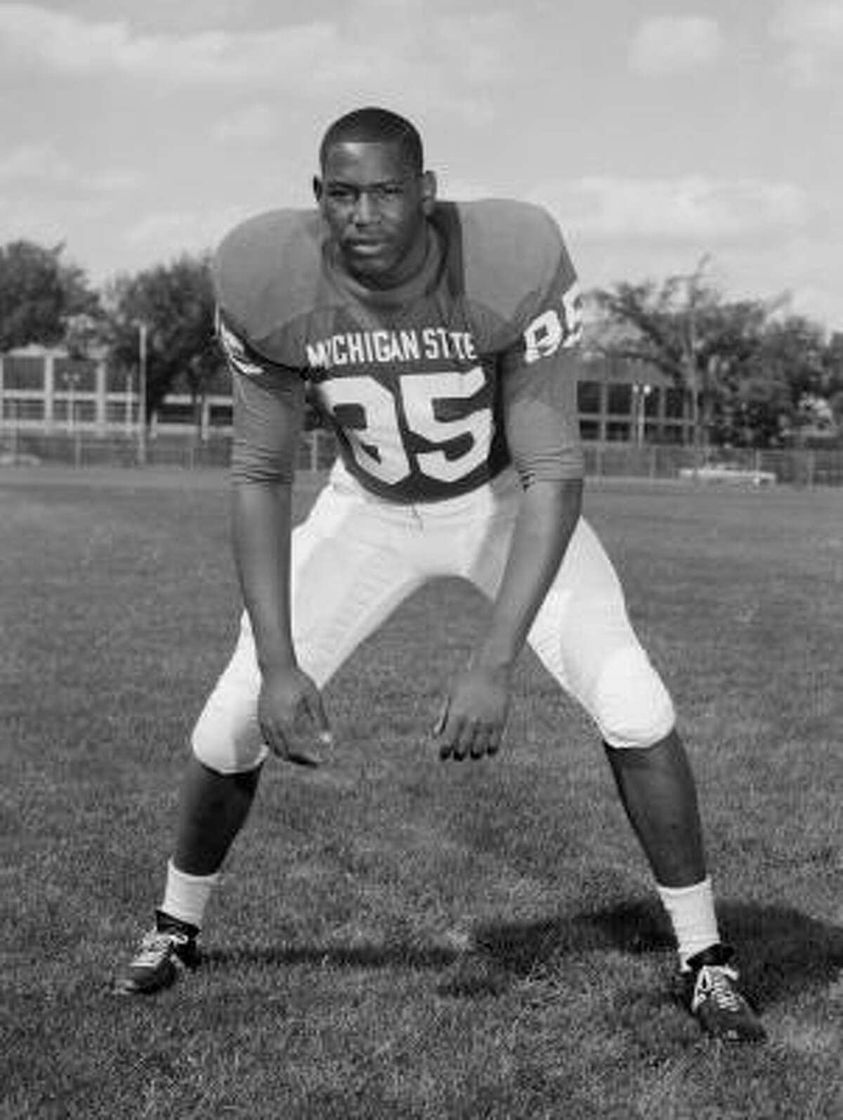 In a photo provided by Michigan State University, date not known, Michigan State football player Bubba Smith poses for a photo. The top overall pick in the 1967 draft after a sensational career at Michigan State, Smith spent five seasons with the Baltimore Colts and two seasons each with Oakland and Houston. He won the 1971 Super Bowl with the Colts.