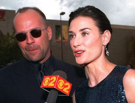 Bruce Willis and Demi Moore were married for 13 years before they divorced in 2000. In 2003, however, they had to pair up again for Charlie's Angels: Full Throttle. Photo: MARK J TERRILL, AP