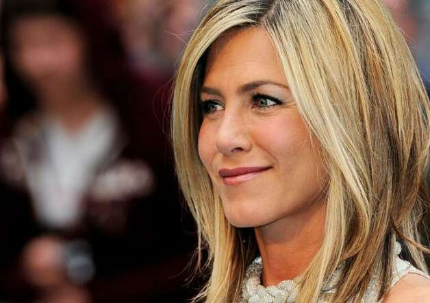 Jennifer Aniston is still looking sexy and classy. Brad Pitt who?  Photo: Gareth Cattermole, Getty
