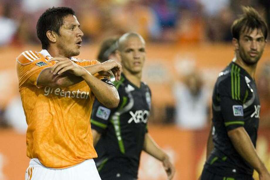 July 30: Dynamo 3, Sounders 1Forward Brian Ching, left, scored a pair of goals to propel the Dynamo to their first victory since July 9. Photo: Patrick T. Fallon, Chronicle