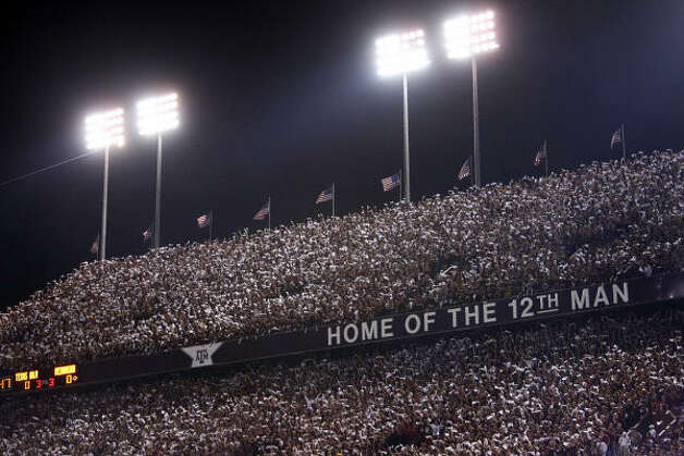 "You'll never confuse the triple-decked home of the ""12th Man"" with any other place in college football. The unique yells and massive noise levels are all the Aggies' own, and when the fans lock arms and ""saw Varsity's horns' off,"" the press box sways as if it's experiencing an earthquake. Photo: TOM FOX/Staff Photographer"