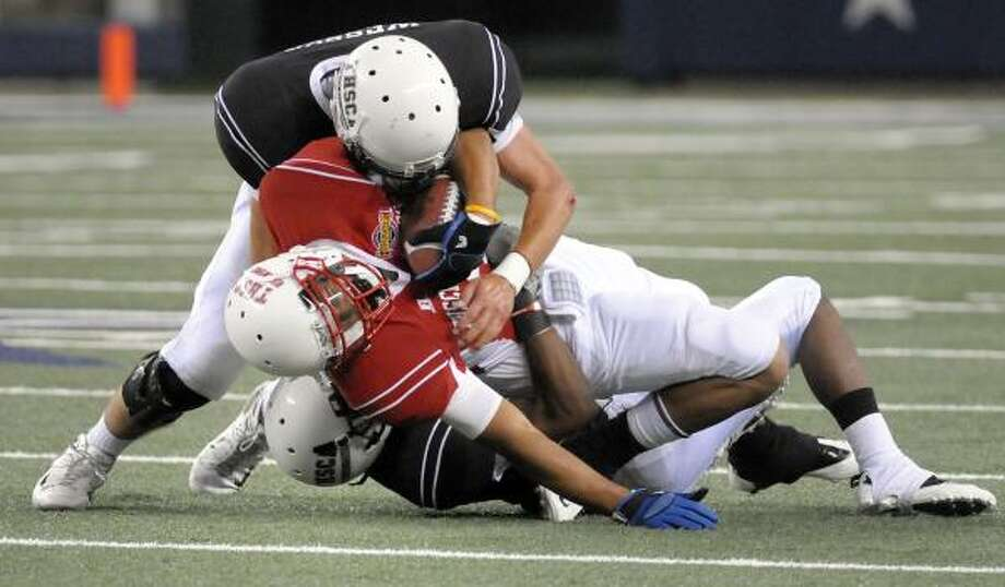 North 38, South 14South All-Stars' Brandon Wilkerson, from La Grange, gets hit by North's Craig Wesson from Odessa Permian High. Photo: Max Faulkner, Associated Press