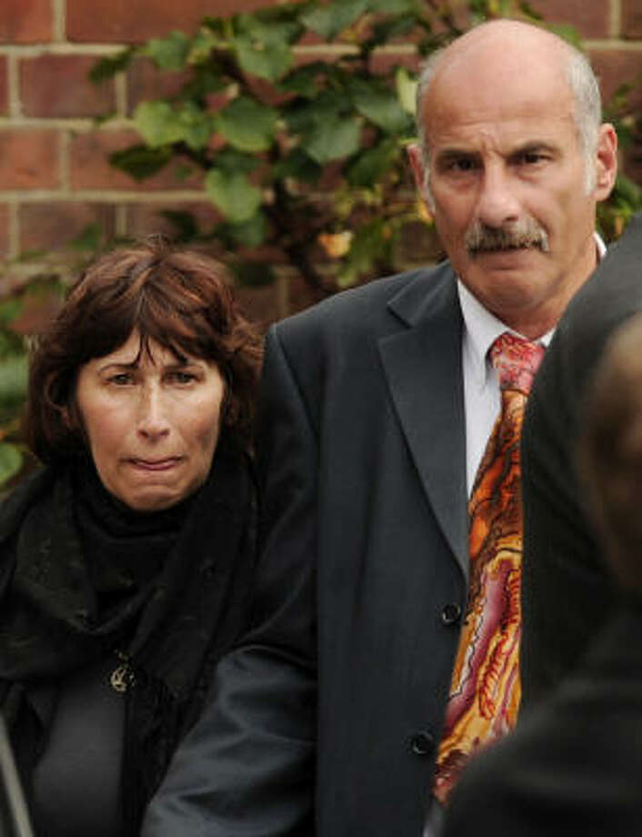 Janis, mother of late British singer Amy Winehouse, leaves after a cremation ceremony for her daughter in north London. Photo: BEN STANSALL, Getty