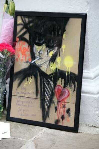 An artist's impression of Amy Winehouse left outside her home in Camden Square on the day of her fun