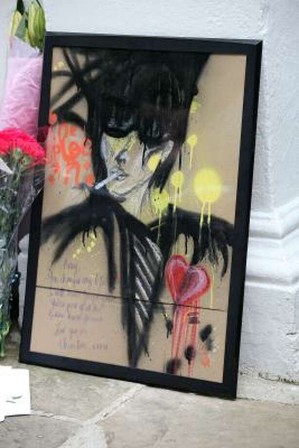 An artist's impression of Amy Winehouse left outside her home in Camden Square on the day of her funeral. Photo: Neil Mockford, Getty