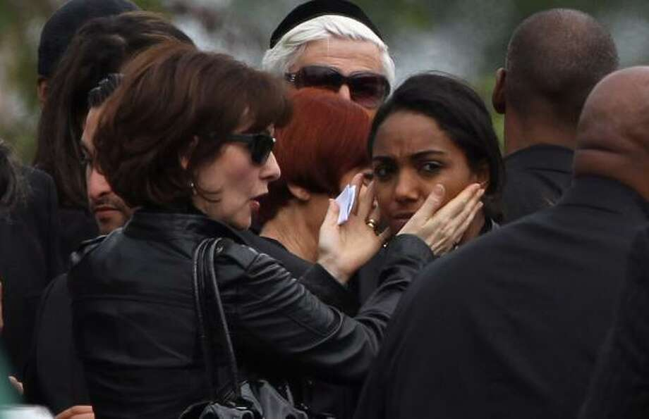 Friends and family attend the funeral service of singer Amy Winehouse.