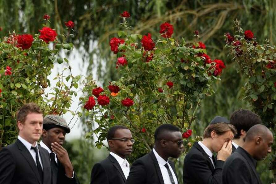 The funeral service of singer Amy Winehouse at Edgwarebury Lane cemetery.
