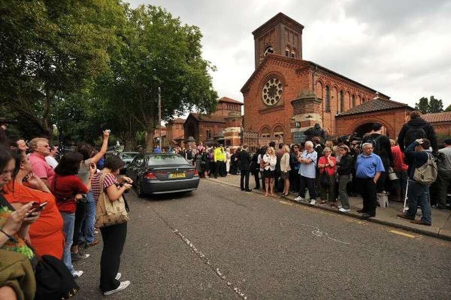 Crowds gather outside a crematorium in north London, on July 26, 2011, as a cermony is held for the late British singer Amy Winehouse. Photo: BEN STANSALL, Getty