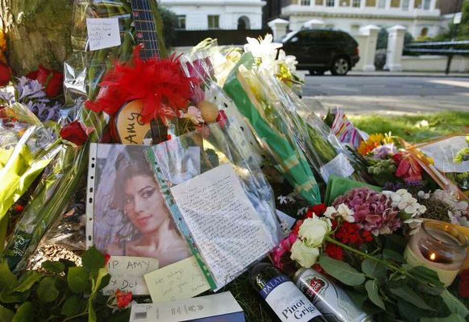 Floral tributes are seen outside the residence of singer Amy Winehouse in Camden Square. Photo: Akira Suemori, Associated Press