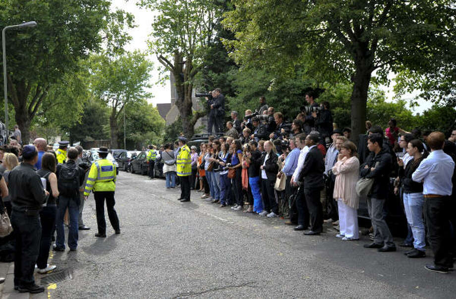 Members of the media and public gather outside a crematorium in north London. Photo: CARL COURT, Getty