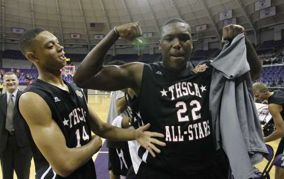 North 103, South 94(From left) Jordan Green and Devonta Abron celebrate the North's victory over the South All-Stars at the Texas High School Coaches Association All-Star Basketball Game at Daniel-Meyer Coliseum on Monday in Fort Worth. Photo: Richard W. Rodriguez, Associated Press