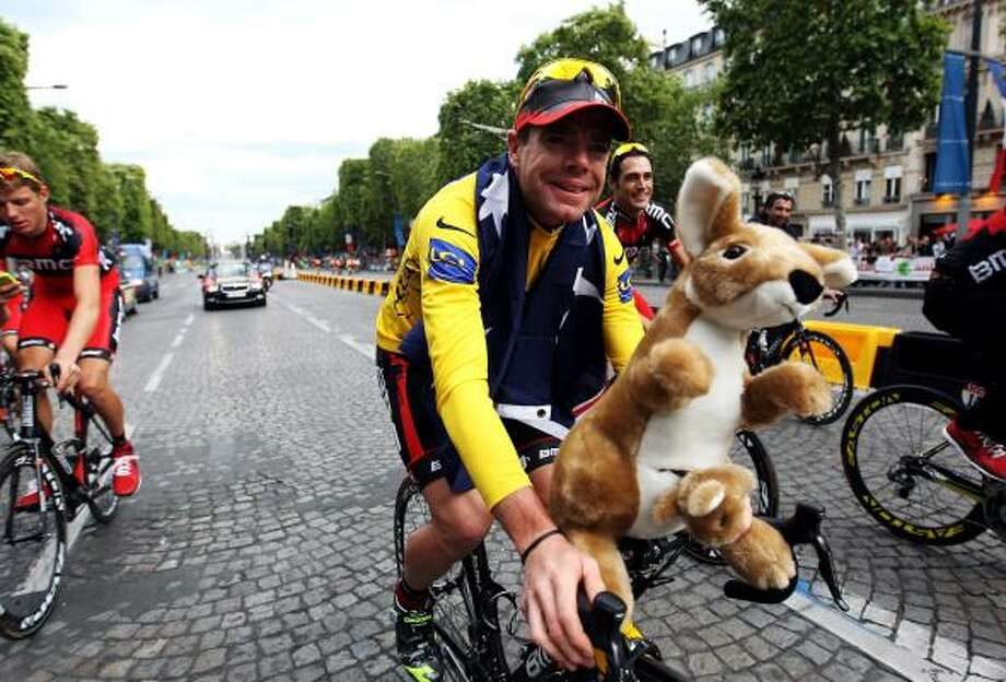 Cadel Evans of team BMC takes part in a victory parade after winning the 2011 Tour de France. Photo: Michael Steele, Getty